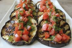 Grilled Eggplant with Fresh Mozzarella, Tomatoes and Basil Vinaigrette. A rustic and fresh light meal or side dish.
