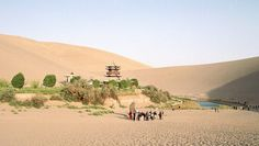 Tourists explore the Crescent Moon Spring along the historic Silk Road trade route. Photo: Wo Shing Au