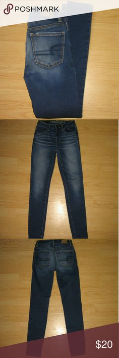 "American Eagle Hi Rise Jegging Skinny Jeans SHORT These jeans are preloved but still in very good condition. These are a Super Super Stretch Hi Rise Jegging. Made of 65% cotton 23% viscose 11% polyester 1% elastane. Tag size is 0 Short.  Waist across with natural dip is 11.5"" Waist across when aligned is 12"" Front Rise is 8.5"" Inseam is 27"" American Eagle Outfitters Jeans Skinny"