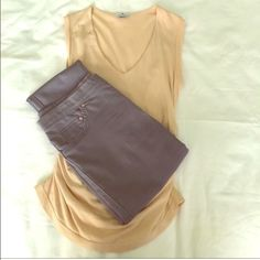 James Perse StretchKnit Sleeveless Top Size 2 James Perse StretchKnit Sleeveless Top Size 2.  Beige/peach color with ruched sides making this top very fitted and sexy.  Gently used and in great condition.  Smoke free home. James Perse Tops Tank Tops