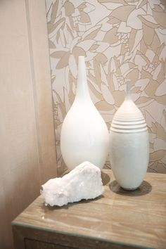 White urns for home decor with a neutral leaf wallpaper decor for how to decorate in neutral tones.