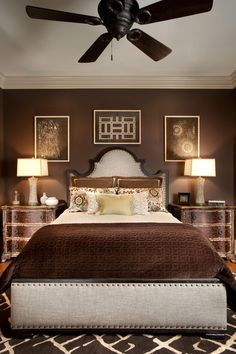 Rich chocolate brown encompasses this bedroom, including the linens, rug, nightstands, walls and artwork. Pops of neutral help break up the color from becoming too monotonous.