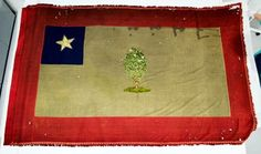 This flag was captured by the 2nd Iowa Cavalry on May 30, 1862 just north of Booneville, Mississippi. It is currently in the possession of the State Historical Society of Iowa, Des Moines, Iowa. This surviving Civil War era flag matches the 1861 Mississippi state Magnolia flag description more closely than any other currently discovered surviving Magnolia sample.