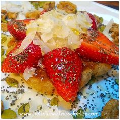 Delicious pancake topped with fresh strawberries, coconut flakes, chia seeds, raw organic honey with activated pumpkin and walnut seeds. #glutenfree #dairyfree #pancake #breakfast #healthy #fresh #cleaneat #nograins #grainfree #sweet #fitgirl #holistic #o
