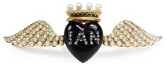 A Victorian gold, diamond and enamel locket/mourning brooch for Ian Douglas Montagu Keith-Falconer, Lord Inverurie, in the form of a winged and crowned black heart with diamonds spelling out 'Ian'; concealed inside are two photographs. (Christie's)