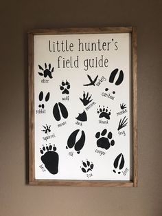 Little Hunters Field Guide Wood Sign, White painted background with black handprinted lettering and stained wood frame.  This hand crafted wood sign is a perfect addition in a nursery for the little love in your life.  Dimensions are approximately 25 1/2 x 17 1/2 x 2 and comes ready to hang up. Any questions feel free to contact me! If you have an ideas of your own, contact me and we can work together to design something special for you!  NOTE: This sign is ready made, you will rece...