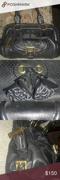 """Vintage Leather Satchel Hard to find gorgeous vintage satchel. 100% leather with intricate detailing such as ruffles, rosettes, perforated, and brass buckles. Outside pouch. Inside zippered and slip pockets with key chain. Brand is no longer made. Zips shut. Appx. 10 x 14 x 5 with 7"""" drop. Serial no.  Lockheart X001766. Excellent used condition. No rips No wear. Only small nail polish stain in bottom lining. Lining may need some cleaning. Offers welcomed! LOCKHEART Bags Satchels"""