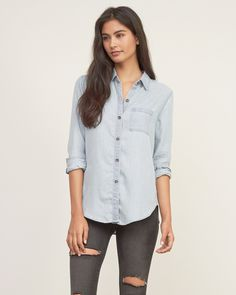 Womens Light Wash Denim Shirt | Go trendy with a denim shirt, detailed with a curved hem and pocket at left chest, Light Wash, Baby Doll Fit | Abercrombie.com