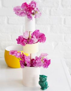 So simple, and so amazing - 'tall' flower arangements, and cheap/sturdy enough that they can easily go out on the patio without any worry...looks like painted cans.