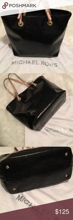 Michael Kors   Black Tote Very nice & excellent condition. Black monogrammed tote with nude colored straps & gold toned hardware. Interior has one zippered pocket as well as four slip pockets. Comes with MK dust bag. Let me know if you have any questions. Bundle to save & happy Poshing! Michael Kors Bags Totes
