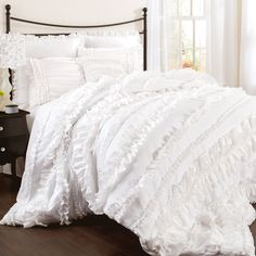 Ruffled white comforter set.Product: Queen: 1 Comforter, 1 bedskirt and 2 standard shamsKing: 1 Comforter, 1 bed...
