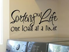 laundry room wall quote sticker decal sorting out life one load at a time. $9.00, via Etsy.