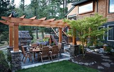 Gorgeous pergola!  Maybe use stone to mimic the front of our house?