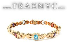 gold bracelet with colored stones