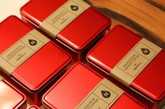 """Do you ever use maple syrup as part of a gift box? These tins would be great for packaging a small bottle of maple syrup along with some maple candies. The """"belt"""" around the tin is called a """"bellyband"""". It's a smart and inexpensive way to add your brand name to the outside of the tin."""