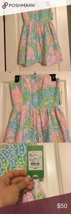 Lace Lilly Pulitzer Dress Never worn super cute Lilly dress! There are two minor flaws as shown in the pictures. The price reflects this, open to reasonable offers. Lilly Pulitzer Dresses Mini