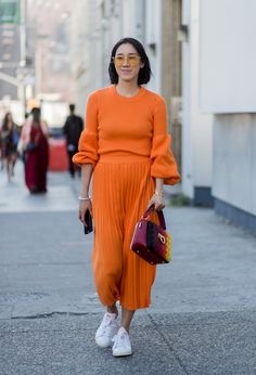 Eva Chen went for it at New York Fashion Week by wearing head-to-toe orange. Going monochrome is one of the...