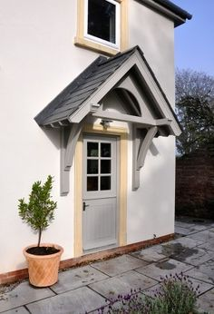 The English Porch Company produce beautiful bespoke and traditional wooden porches, porch kits, porch frames, oak framed porches and canopy porches in the UK. Cottage Front Doors, Front Door Porch, Cottage Porch, Front Porch Design, House Front Door, House With Porch, Porch Entrance, Welsh Cottage, Side Porch