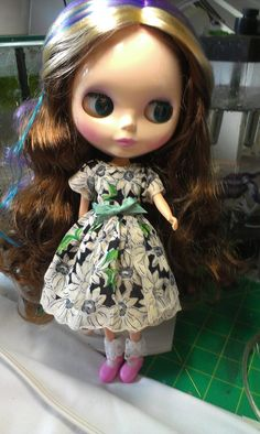 This is another Blythe dress made from a hanky.  The hanky is Navy blue with white daisies and some green leaves.  The dress has two skirt layers and comes with a tiny crinoline petticoat.