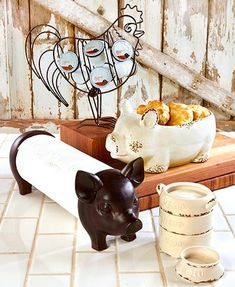 Bring a touch of country charm into your kitchen. Its black and white color combo coordinates with any existing decor.