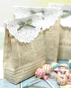 Gift wrapping idea. Newspaper gift bags with patterned paper and ribbon.