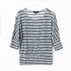 BCX Asymmetric Stripe Silver & Grey Top So chic! A great casual piece for the fall/winter. Light pilling throughout. Silver weaved into fabric.   • BECAUSE OF LIGHTING, PLEASE BE AWARE THAT COLOR OF THE ACTUAL ITEM MAY SLIGHTLY VARY FROM THE PHOTOS • MAKE ALL OFFERS USING THE OFFER BUTTON  • NO TRADES BCX Tops Blouses