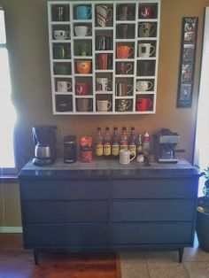 Schaaf House: The coffee bar. Updated dresser as base and hanging custom coffee cup rack hanging above on the wall. Love it!