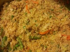 Chicken, tofu fried rice with snap peas, carrots, peas, onions, bean sprouts, seasoning: fresh minced ginger, garlic, soy sauce, salt, topped with cilantro and scallions.