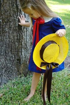 A Story About a Little Girl In Paris,Madeline| Pretty Blue Dress With a Red Bow Paired With a Yellow Brimmed Hat.