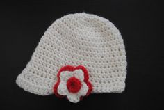 Girls crochet newsboy cap with small peak and flower detail. Off-white cap with red and off-white flower. Other colours available. on Etsy, $18.00 AUD