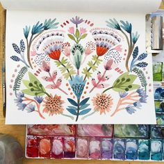 Symmetrical designs are always welcome in my sketchbook! I start by painting from the center and work my way outward. I will paint a flower or plant on the left and then mirror it on the right. I start on the left so when I switch to paint on the right, my hand does not block what I just painted on the left. I'm a righty so I think the opposite would apply for a lefty!#createeveryday #art_we_inspire #creativeprocess #surfacedesigner #showyourwork #surfacedesign #watercolorpainting #cr...