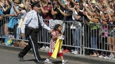 Sophie Cruz is escorted away before being called over by the Pope.