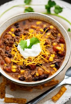 Crock Pot Taco Soup With Black Beans, Pinto Beans, Petite Diced Tomatoes, Sweet Corn, Green Enchilada Sauce, Chicken Broth, Taco Seasoning, Corn Starch, Lean Ground Beef