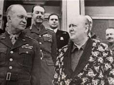 "After the Teheran Conference, Churchill contracted pneumonia, followed by a heart attack. He was well enough by Christmas Day, however, to discuss military plans with General Eisenhower (left) and Field Marshal Harold Alexander (second from left) in Carthage. Churchill is shown wearing his famous dragon-emblazoned dressing gown over his even more famous ""siren suit""--a one-piece zip-front jumpsuit named for its simplicity in putting on quickly at the sound of an air raid siren"