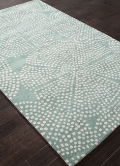 This new gorgeous Aruba Blue hand tufted rug is sculpted with an ivory sea urchin-like pattern spread across the entire rug.