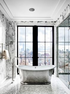 """""""Only the birds will be shocked,"""" reads a New York Times article. For ultra-rich Manhattanites, views are not limited to the living room—they extend to the bathtub, and it usually involves..."""