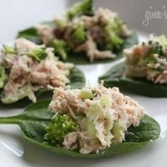 Spoon lean tuna salad onto spinach leaves as finger food or a light lunch.