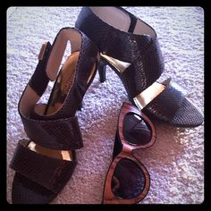 Michael Kors Snake SkinEmbossed sandals Beautiful size 6.5 Michael Kors Brown snake skin embossed sandals with a three inch heel. A shoe for all occasions. Will fit in your summer wardrobe perfectly. MICHAEL Michael Kors Shoes Sandals