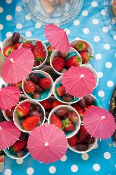 Pre-portioned fruit in paper cups is a great serving idea for summer parties // Party Food & Drinks Ideas