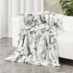 6d53e8b78a Authentic natural tones create a truly stunning piece. This blanket is  crafted with super soft. Fur ...