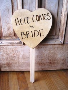 Here Comes The Bride Sign instead of flowers for the flower girl