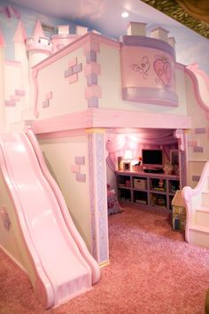 This playful pink bedroom is any little princess's dream. The custom castle features a cozy loft bed nestled within fortress walls and a slide down to the princess play area.