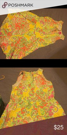 Lilly Pulitzer for Target Romper Yellow, orange, and green Lilly Pulitzer for Target romper. It has a tie in the front and a button in the back. It is a short romper. Lilly Pulitzer for Target Pants Jumpsuits & Rompers