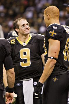 Quarterback Drew Brees #9 is congratulated by Jimmy Graham #80 of the New Orleans Saints after Brees threw a nine-yard touchdown pass to running back Darren Sproles #43 and broke the single-season passing record in the fourth quarter against the Atlanta Falcons at Superdome on December 26, 2011. The Saints defeated the Falcons 45-16.