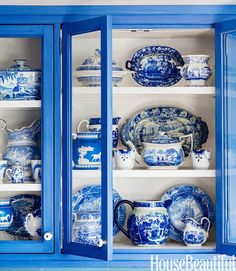 Classic china gets an extra boost of blue in a bright cabinet.