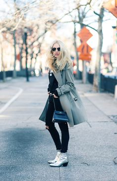 Shea Marie creates a striking and edgy look by wearing her black jeans with patent silver ankle boots and a stylish teal overcoat. Finish the look with some classic retro shades to steal Shea's style! Brands not specified.