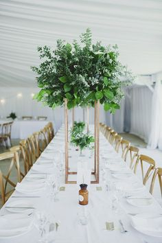 Modern minimalist wedding reception centrepiece with greenery | LiFe Photography | See more: http://theweddingplaybook.com/wedding-playbook-magazine-volume-10/