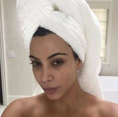 Pin for Later: Kardashian Makeup-Free Selfies That Will Inspire You to Go Bare Kim Kardashian Not even Kim is perfect (though she comes pretty close)! She revealed undereye circles in this postshower selfie.