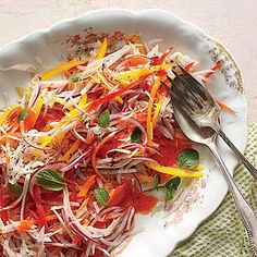 Jicama-and-Bell Pepper Slaw | Thinly sliced jicama, mint leaves, juicy bell peppers, and Strawberry-Lemonade Jam make for a deliciously refreshing slaw. | SouthernLiving.com