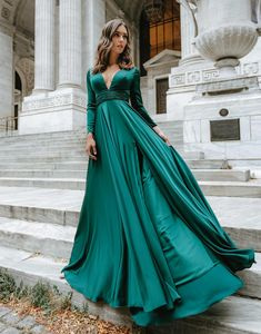 Look effortlessly stunning in this A-line, long sleeve, plunging gown with a leg slit. A gathered belt separates the bodice and the skirt flows into a ravishing train. Dark Green Prom Dresses, Green Wedding Dresses, Emerald Green Dresses, Cute Prom Dresses, Prom Dresses Long With Sleeves, Prom Outfits, Ball Dresses, Dark Green Long Dress, Long Formal Dresses